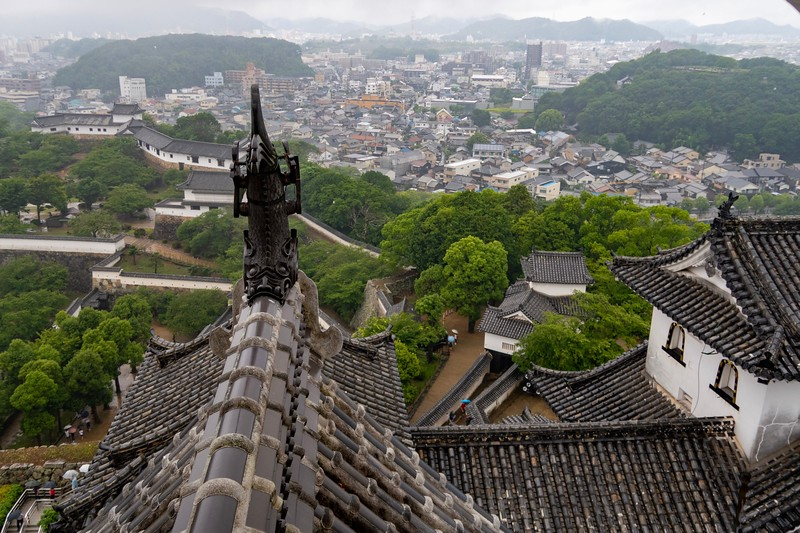 A view from the top of Himeji Castle of the town of Himeji (or at least a small part of it).  A view of all of the trees below highlights why this must be an absolutely amazing site when Cherry Blossom time comes in April.