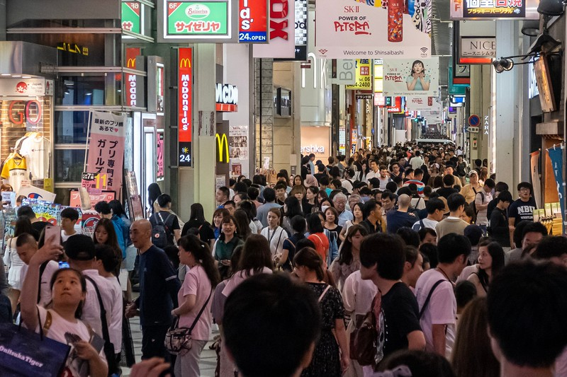 """Every Japanese city that I've ever been to has a long pedestrian outdoor mall (usually covered, but certainly outdoors) spanning several city blocks.  This becomes a big hangout place where you can find all manner of things to buy and eat.  Osaka's Shinsaibashisuji-suji area was more than I had ever seen before.  As you can see in the photo, people are packed together as far as you can see.  It's miles of stores - including several indoor malls (that are so incredible that they deserve their own post.  Imagine Amazon, but everything is there in front of you - there's NOTHING like it in the states).  I don't love being in large groups of people typically, but there was something about the anonymous nature of being in your """"Gaijin Bubble"""" and being able to move through the crowds as if they weren't even there."""