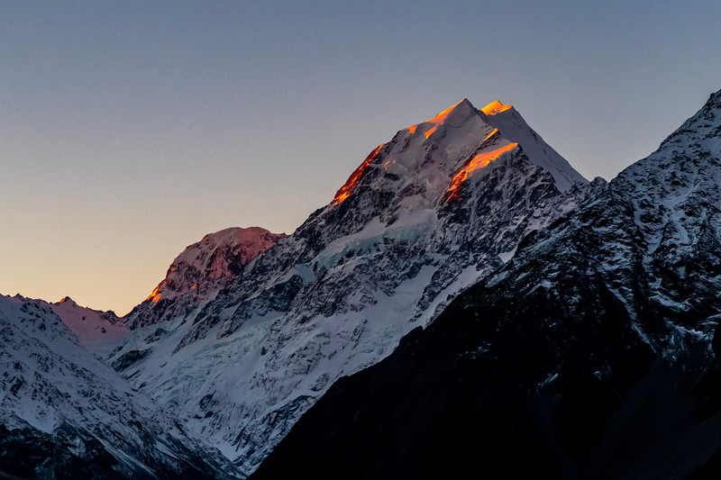 Beautiful sight as the last rays of sunset reach the upper peaks of Mt. Cook.