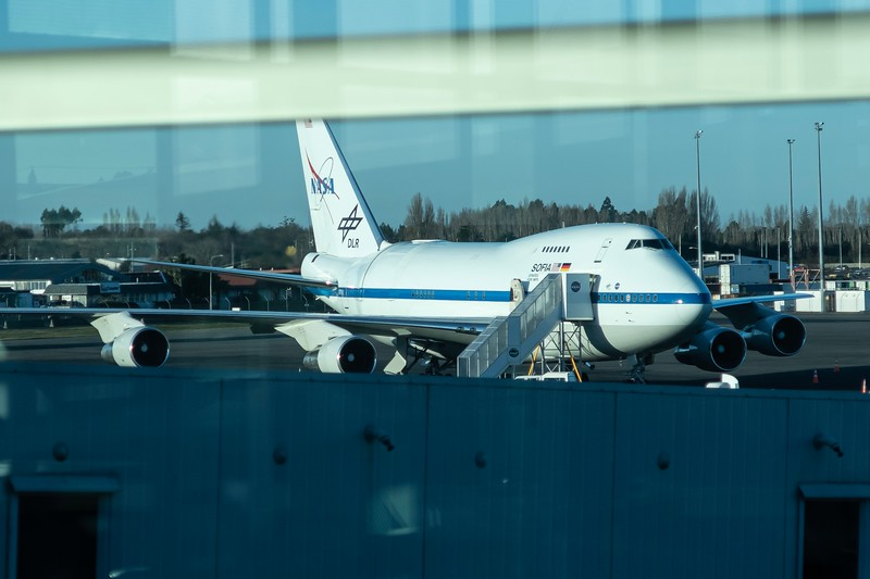 Parked on the tarmac of the Christchurch Airport is NASA's SOFIA aircraft.  This is a modified 747 with a giant door in the back of the plane that hides a telescope.  The airplane is able to fly very high above a lot of the atmosphere and take much better images than would be normally practical on Earth.  Really cool plane!