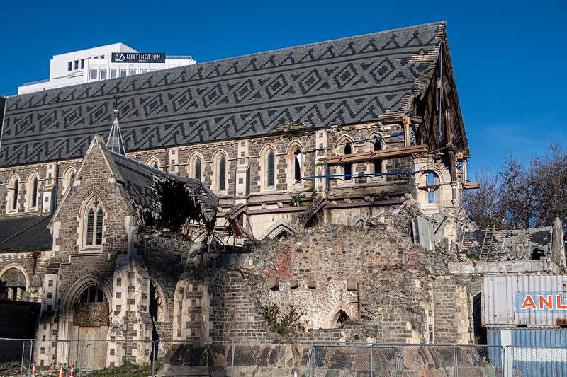 The Christchurch Cathedral was destroyed by the earthquake, including the bell tower directly in the front of this photo.  There have been many legal fights about what to do with the cathedral (and who should pay for it), but the final story seems to be that the church will be rebuilt as it was before the quake.