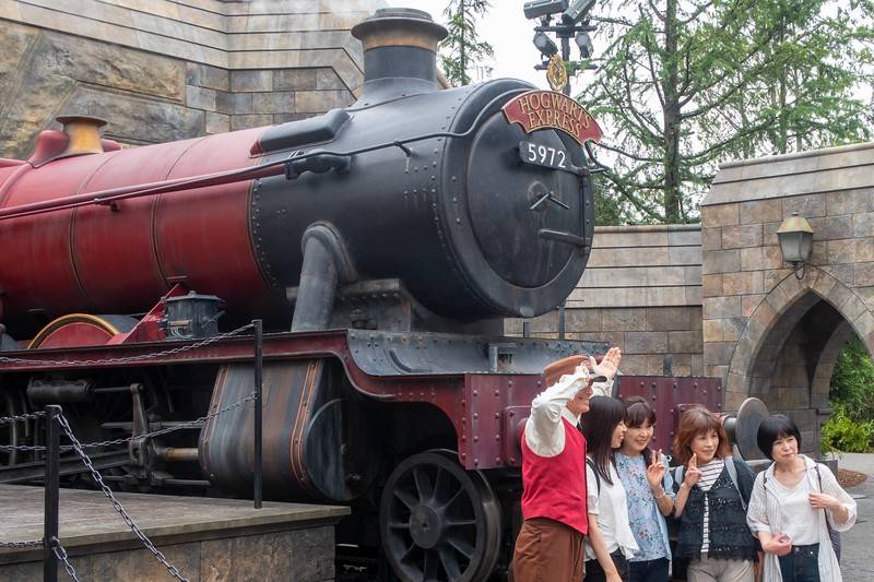 Japanese people have to get a shot with a train!