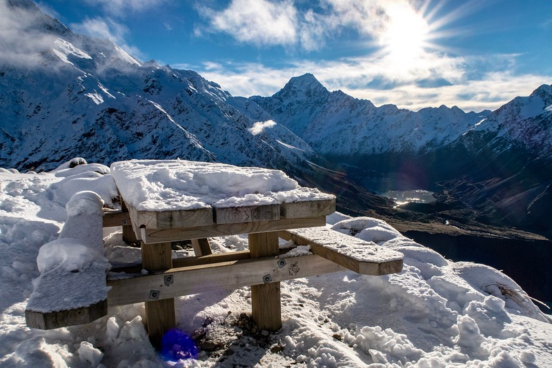 At the halfway point, the ground was pretty well covered with a few inches of snow.  This nice picnic table was set up and there was a great view.  Problem was...there was more mountain left that I hadn't climbed.  It didn't look like too big a deal (Narrator: It was a big deal...)