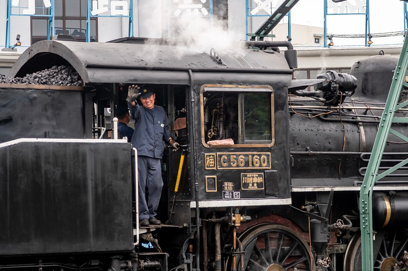 There were a ton of steam trains kept in the station.  This is a train that they use to pull around tourists.  As it was the end of the day, they backed the train onto a roundabout and rotated it around a few times so everyone could get a look.  One of the drivers was hamming it up as well!