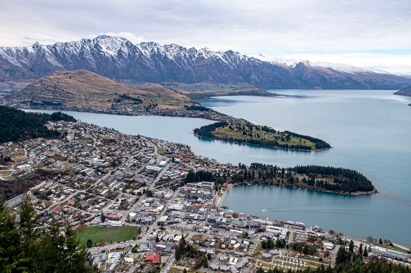 "The next morning, I went for a bit of a hike.  This is about halfway up and shows a good bit of the town of Queenstown.  Most of my time was spent in the bottom right quadrant - the main touristy part.  The mountains in the back of the shot are known as the ""Remarkables"" - an apt name if there ever was one."