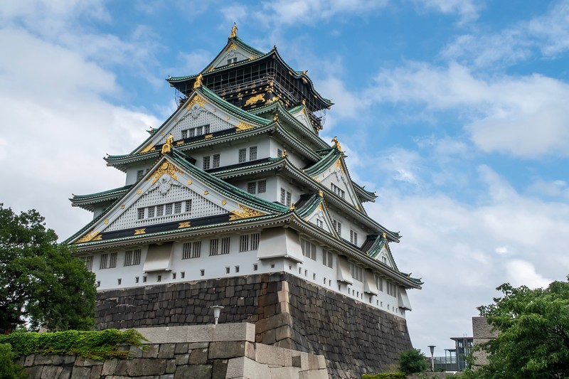 Another nice shot of Osaka Castle.  The inside of the castle is pretty much a modern building.  I was able to get to the top of the castle...view wasn't the best on a slightly gloomy day.  One interesting view was a field full of police vans for transporting arrested people.  Now, Japan is a pretty peaceful place - this huge number of paddy wagons seemed strange.  Then I remembered that the G20 Summit (featuring 20 of the most important governmental leaders and all of the associated protestors) had finished in this very city the day before.  I never really noticed anything other than the Bullet Train I took on the way down saying that they had removed trash cans from the stations for the G20.