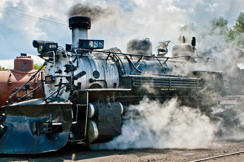 A working steam locomotive! <br /> Brass bell ringing, whistle blowing, steam belching. The primer red object to the right in the background is a locomotive boiler, without the whistles and bells.