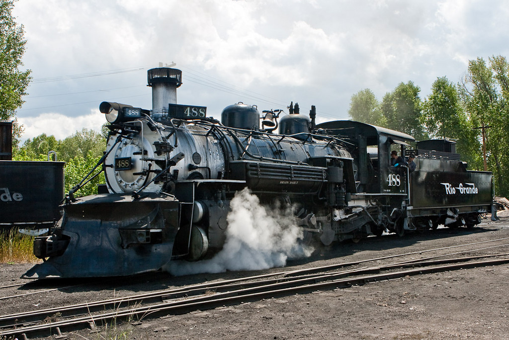 In Chama, New Mexico, the The Cumbres and Toltec Scenic Railroad is hard to miss. What's particularly great about this place is that you are free to roam around the yard and photograph at will. Here some worker guys are taking little 488 for a little spin down the track. They cleaned out the fire box and loaded the tender (that little car behind the cab) with fresh water.<br /> <br /> The Cumbres and Toltec Scenic Railroad (C&TS) is a narrow gauge heritage railroad running between Chama, New Mexico and Antonito, Colorado. The track was originally laid in 1880 by the Denver and Rio Grande Railroad. Starting in 1970, the railroad began to take tourists on six-hour trips between the two towns, using steam locomotives.