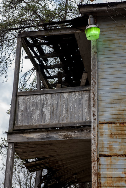 Even though the house was abandoned, the gren lamp was lit