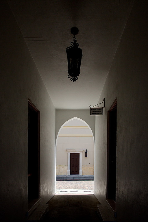 An interesting hallway through a building in Winter Park. The doorway and gas light across the street look European to me.
