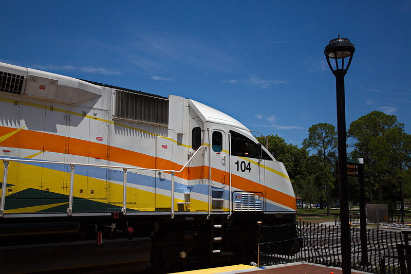 Central Florida's new commuter rail system is called SunRail. This is one of its diesel engines at the Winter Park station. It pulls three passenger cars. It's been running for about a month and already there have been one collision with a utility trailer, one collision with a stalled passenger car (both at crossings) and one mechanical delay.