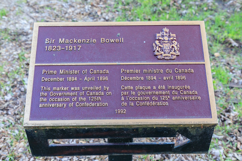 Government of Canada erected pointer to the grave of Prime Minister Sir Mackenzie Bowell 1823-1917.