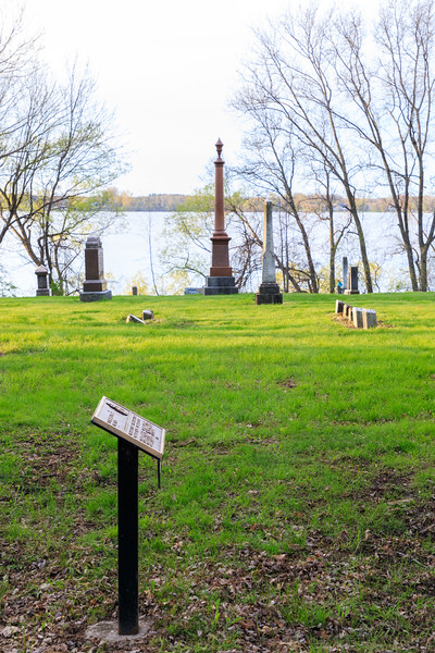 Government of Canada erected pointer to the grave of Prime Minister Sir Mackenzie Bowell 1823-1917. Tombstone is tall marker in centre frame.