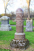 Henderson tombtone. Stphen R. Henderson September 1, 1898 to October 21, 1905. Cylindrical stone with semispherical top.