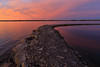 Purple sky and water around breakfwater at Jane Forrester Park looking across the Bay of Quinte.