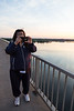 Denise Lantz taking a picture at sunrise on the Norris Whitney Bridge over the Bay of Quinte.