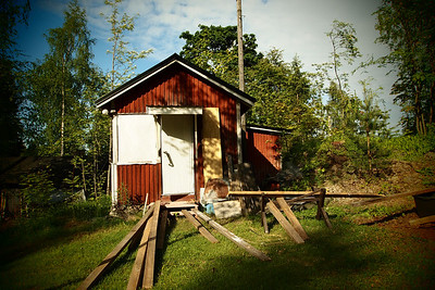 Old style small red country house in Finland.