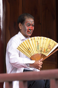 A performer fanning himself in between performances.