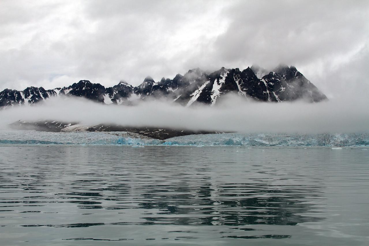 monaco glacier and perpetual clouds
