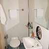 This is the toilet and shower in my cabin aboard the Mälardrottningen yacht in Stockholm. The washbasin and mirror swing to the left to create the shower, very good design I thought.