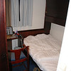 The cabin's bed, small but very comfortable. There's a top bunk which pulls down to make it a twin room