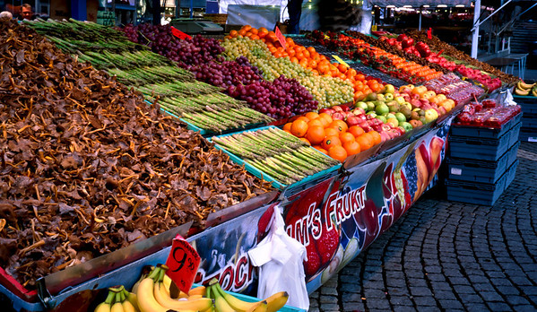 Asparagus and chantrelles are featured in this fruit stand at the Concert Hall street market, Stockholm.
