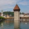 Interlaken, tower and covered footbridge over river