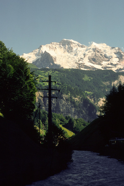 From Interlaken there is a small  train to the alpine region and Lauterbrunnen at 796 m above see level. In the backgroun Eiger (3970 m), Mönch (4099 m) and Jungfrau (4158 m)