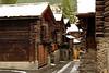 Old structures on a side street in Zermatt.