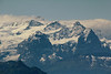 200 MM telephoto look at the famous Monch, Junfrau and Eiger mountains of the Alps. Taken from Mt. Pilatus near Lucerne. Distance is about 32 miles.