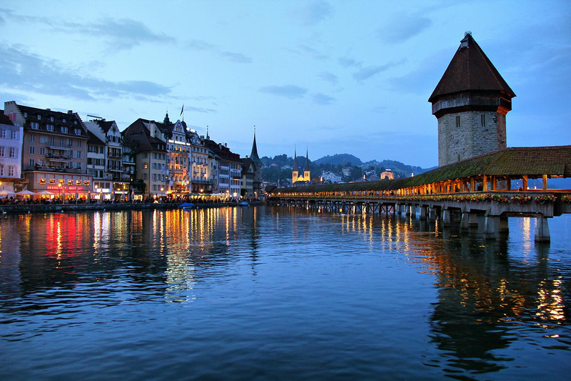 The old prison tower and Chapel Bridge in downtown Lucerne, built in the 1300's. Lucerne was the fifth most visited city in the world in 2010.