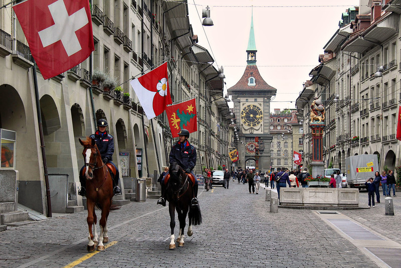 Mounted police in Bern, Switzerland slowly comb the streets with casual but regal confidence. Bern was established in 1191 A.D. and has kept its Old World feel. Downtown had been spared modern structures.