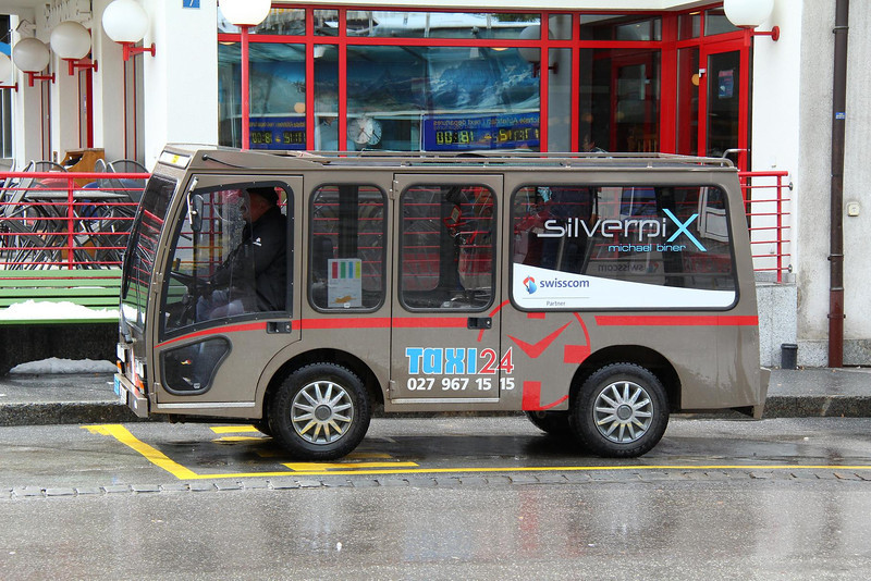 Electric Taxi in Zermatt. No private cars or buses are allowed in the city. All streets are dedicated walkways, with an occasional electric vehicle weaving through the people.