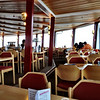 Schilthorn / Piz Gloria - this is the interior of the revolving restaurant.  The part on the right side of the red posts is revolving, while the other part is stationary.  I enjoyed a fine hot meal during my visit.