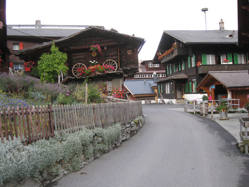 "Mürren - another view of the main street, and one of the most photographed buildings in town, with the distinctive ""wagon wheel floral arrangement""."