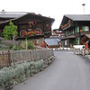 """Mürren - another view of the main street, and one of the most photographed buildings in town, with the distinctive """"wagon wheel floral arrangement""""."""