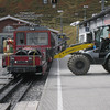 "Kleine Scheidegg - this shows the small ""trailer"" which is attached to the Jungfraubahn trains, which is used to haul cargo up and down the mountain.  The Fork Lift appears to be loading some type of construction materials."
