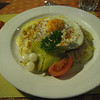 "Lauterbrunnen - this is ""Oberland Rösti"", as served at Hotel Oberland.  Rösti is a specialty of the Berner Oberland, and basically consists of hash brown potatoes covered with a variety of toppings.  This version featured ham and onions, topped with Emmental (or other locally made Swiss cheese), a fried egg and garnish items (it was VERY good).  Other versions are accompanied by sausage in onion gravy."