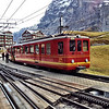 Kleine Scheidegg - these are some of the distinctive Jungfraubahn rail cars which travel 9 km to the Jungfraujoch, which is the highest rail station in Europe at 11,333 feet.  Construction started on this in about 1896 and the first section to the Jungfraujoch wasn't completed until 1912.  Much of the trip runs through tunnels carved into the peaks of the Eiger and Mönch.  There are two intermediate stations, where passengers can disembark to have a look at the scenery through large windows mounted in the side of the mountain.