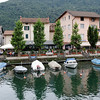 Switzerland / Lugano - the tour boat passed this small collection of lakeside restaurants, with boats docked in front.