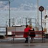 Switzerland / Lugano - this couple was enjoying some quiet time on the lake, regardless of the weather.