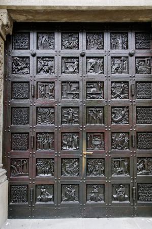 "Portal The Grossmünster (""great minster"") is a Romanesque-style church in Zurich, Switzerland"