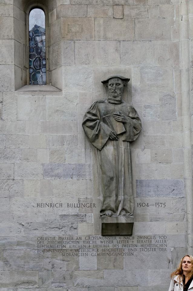 Statuary relief of Heinrich Bullinger on the southern exterior wall<br /> Grossmünster, Zurich, Switzerland