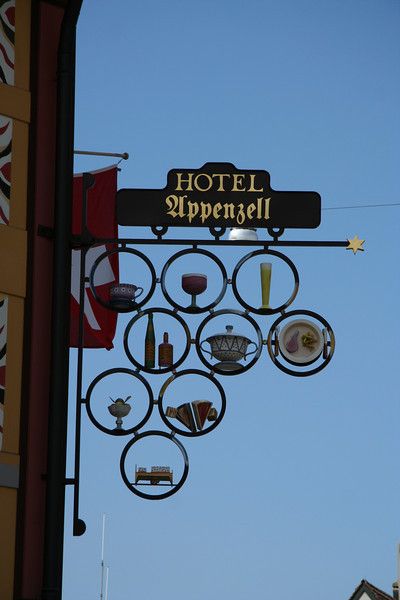 Sign outside Hotel Appenzell, showing everything they offer in their restaurant, in 3D.