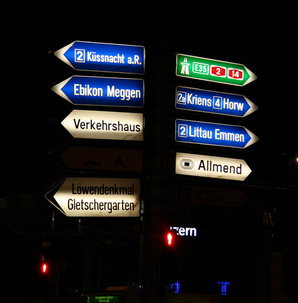 Street signs in Lucerne in front of the train station.