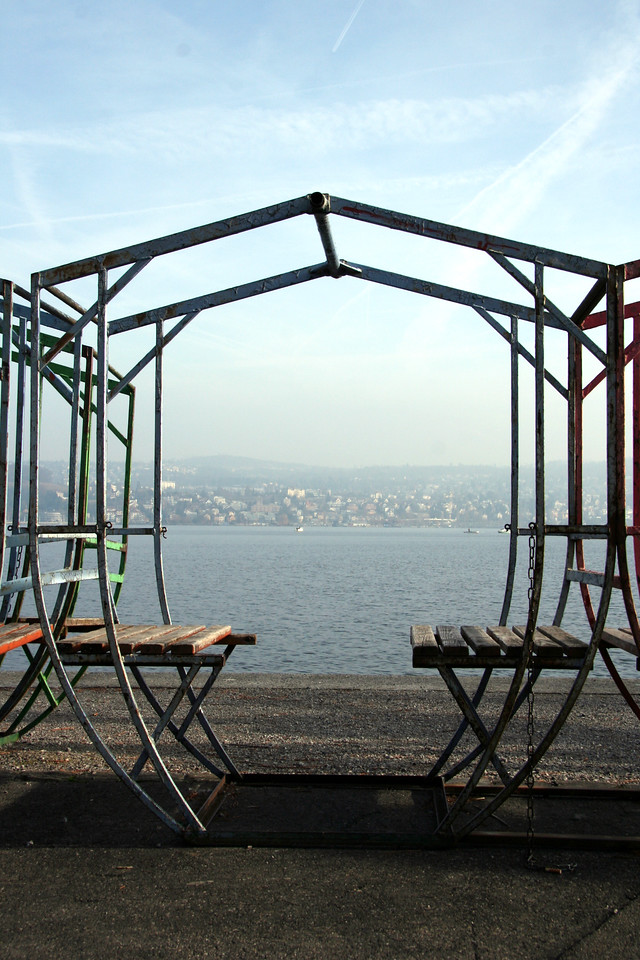 These appear to be old ferris wheel seats or swings or other type of ride. Lake Zurich in the background.