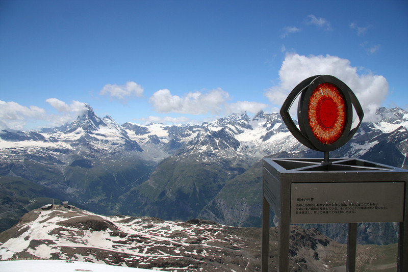 "View from the highest point you can hike to without climbing gear. This is from the top of Oberrothorn, 3141m up (11,200 ft). The glass eye is part of a series of eyes with quotes describing mineral, plant, animal, human, and spiritual life as one progresses higher up the mountain.<br>  This one says: ""The spiritual world. The final liberation - free of body and emotion. It is everywhere and is reflected in the beauty and unity of life. It is the infinitely good and loving force - the soul. Wake up and search in heaven's seventh direction."""