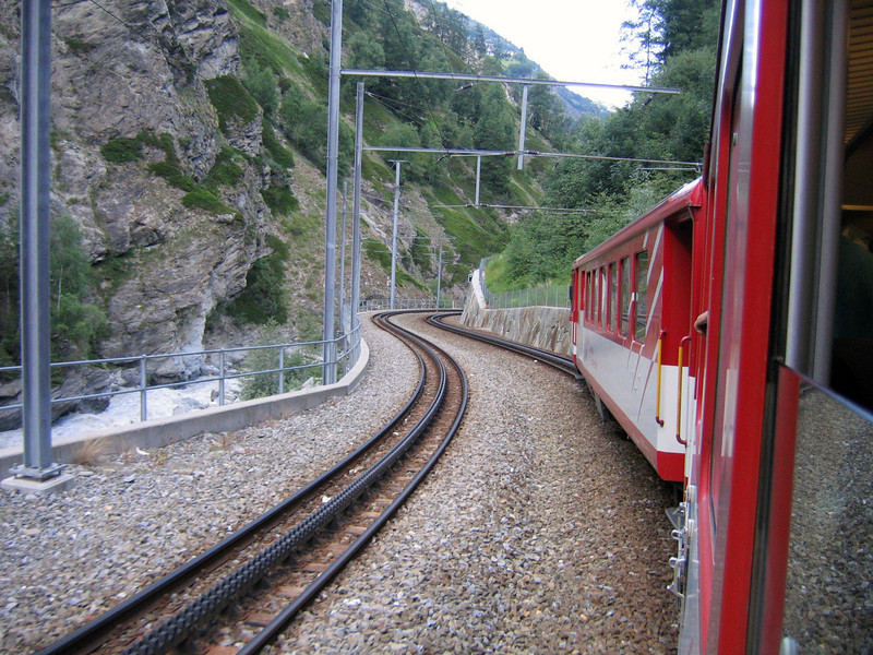 The red trains that climb the mountains. They are actually cogwheel trains as you can see by the track (yes I only just figured this out now).