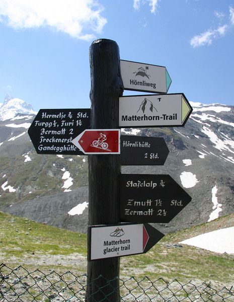 Signs showing the way to trails, mountain biking, and huts. The hand painted directions were lovely.