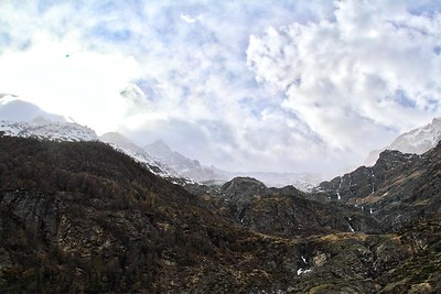 Rugged Alps with Clouds